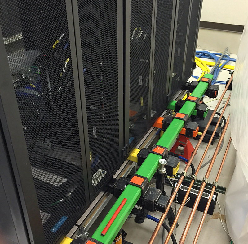 Jacks and support structure under the row of server cabinets.